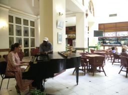 Natalie trading ideas with a Cuban pianist